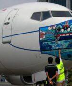 Pesawat Garuda Indonesia 'Pakai Masker', Apa Tujuannya?